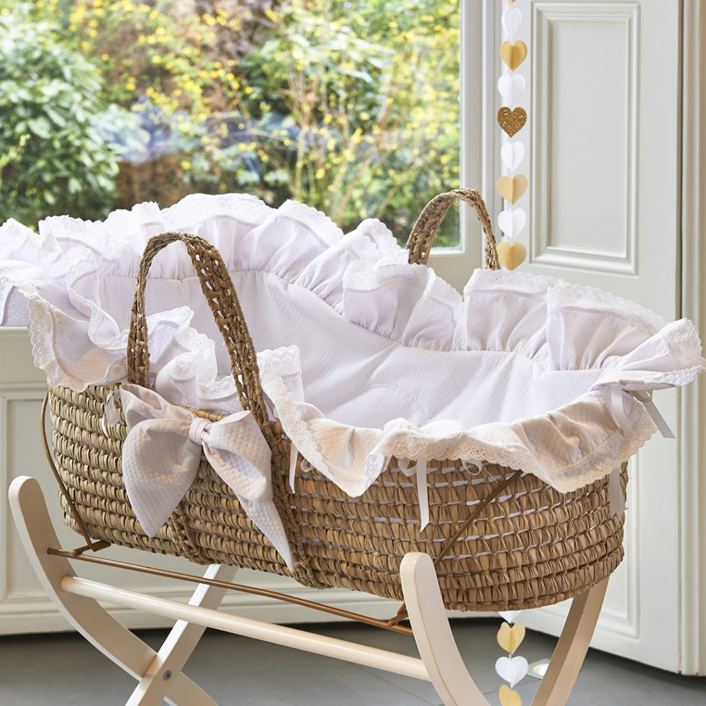 Exclusive to Blue Almonds, this Moses basket has been designed with a Royal Prince or Princess in mind. Finished in pure white and accentuated with subtle side bows and lace trimming, it is suitable for either a boy or girl. Its portable design makes it very practical to use. The basket includes a little decorative pillow and mattress.